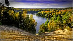 Pure Michigan: The sands falling into the Au Sable River draws you into the colors of fall in Michigan. Eagle's Nest Overlook is one of the most famous overlooks in the Huron National Forest.  Follow River Road National Senic Byway near Oscoda and Tawas Michigan.