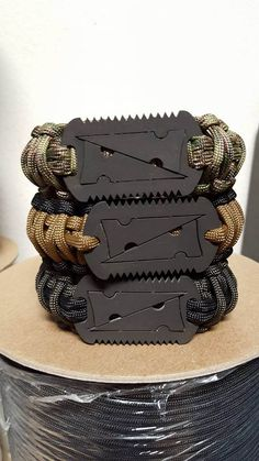 https://flic.kr/p/AdDrFJ | Paracord bracelet/band sandwich from The Para-Cord Guy. Two model 12-5 Arrowcard dogtags with a model 12-3 in the middle.