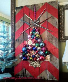 How to Make a Chevron Pallet Ornament Christmas Tree....trace chevron design & paint, place top star & glue, trace out tree outline & hot glue ornaments to fill inside