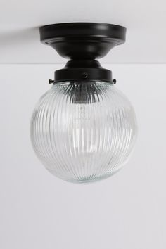 Clear Ribbed Glass Globe Light - Black Base