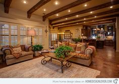Close to Perfect Traditional Open Living Room Ideas | Home Design Lover  Image: ML Baxley  The different shades of browns used in this living room are beyond words – the color combination is a bit rustic in a way because of the colors, but the aura is just superb. Having a view of the kitchen from this space is great too.