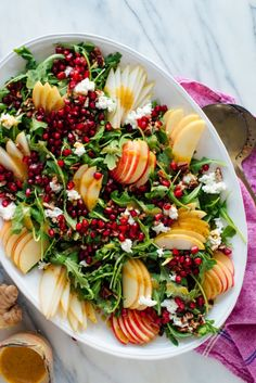 This gorgeous salad is bursting with flavor and fresh fruit! Featuring pomegranate Bartlett pear Honeycrisp apple goat cheese pecans and arugula this salad will brighten up your holiday table. Pomegranate Salad, Pear Salad, Apple Salad, Pomegranate Recipes, Vegetarian Recipes, Cooking Recipes, Healthy Recipes, Healthy Salads, Healthy Food