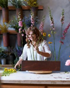 Inspired by fields of wildflowers, a Los Angeles floral designer is making a name for herself by creating vibrant arrangements that practically leap right out of their planters. Take a peek inside her studio—and pick up a few foolproof tips for making bouquets that will take on a life of their own. One of Clover Chadwick's fondest memories of growing up in Los Angeles was bounding into the family car as a young girl and being whisked away on a road trip. Sitting in the backseat, she