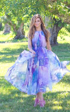 With its passionate watercolor print and fluid gossamer gown sway, this watercolor floral maxi slip dress offers up a refreshing first-of-summer look! Floral Watercolor Maxi Slip Dress in Violet featured by Achicvoyage Blog