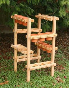 Awesome! This would look great full of flowers, or it would be perfect for starting seedlings - with smaller pots and slots it could house a lot of seedlings.