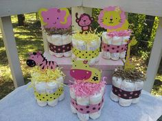 6 Jungle theme mini diaper cakes for GIRL, baby shower centerpiece. $43.00, via Etsy.
