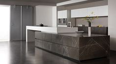 Contemporary kitchen / Corian® / limestone / island GRAFITE BROWN eggersmann küchen GmbH & Co. KG