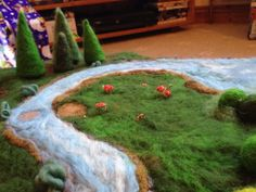 Magic Fairy Ring (with toadstools) on playscape I made for my 6 year old niece. Using wet felting, needle felting and sewing.