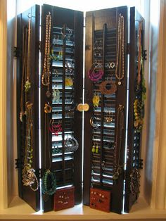Old shutters turned jewellery display/holder
