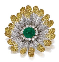 Emerald and diamond brooch, Bulgari, circa 1970. Sold by Sotheby's.