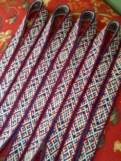 Tablet woven band. Pattern is based on Finnish Iron age finds, design by Maikki Karisto and Mervi Pasanen, from out new tablet weaving book Omenaisia ja revonneniä / Applesies and Fox Noses(Salakirjat 2013)
