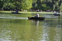 BOATERS ON LAKE IN CENTRAL PARK