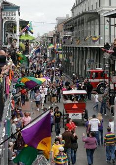 I want to watch a mardi gras parade from the balcony of a hotel on bourbon street.