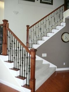 Rod Iron Spindles for Staircase | staircase. Square newels add so much character and wrought iron ...
