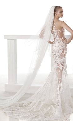 Gorgeous wedding dress by Pronovias - totally elegant lace, amazing train. See more: http://www.weddingforward.com/24-most-gorgeous-wedding-dresses/ #weddingdresses #weddingdress
