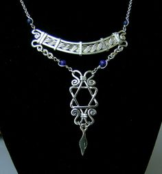 Star of David as pendant with scrolls