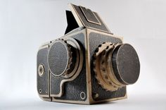 Kelly Angood - Screen-printed corrugated cardboard medium format camera designed to function as a pinhole camera and accept 120 film.