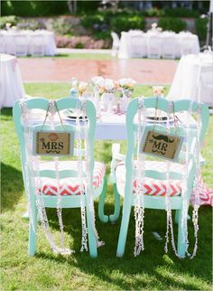 sweetheart table with bride and groom #weddingsigns #weddingchicks http://www.weddingchicks.com/2013/12/20/mint-and-peach-wedding/