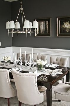 Elegant dining room- I love the contrast between the dark walls and light chairs