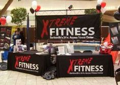 Here's a great booth display with logo table covers from Xtreme Fitness!
