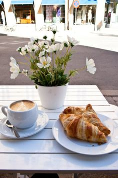I wish I was sitting there taking this photo b/c that would mean I'm somewhere amazing and I'd be eating those croissants and drinking that coffee.