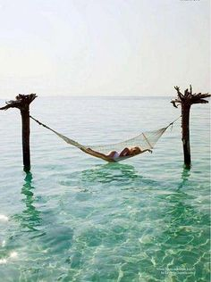Let's take a nap, on a hammock in the ocean.