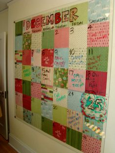 Calander made with paper squares and covered in plexiglass