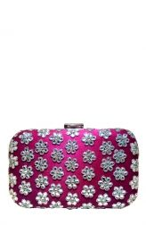 Fabulous deep pink silk clutch has a rich and luxurious appeal. Adorned all over with pretty kundan flowers, this Meera Mahadevia clutch is the perfect party accessory. Suitable to be used with a contemporary or traditional outfit, this vibrant clutch can brighten up your look and serve as a statement piece when styled with a pain outfit to make an impact.
