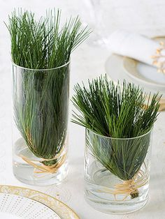 Quick Thinking  --  Need a last-minute table decoration? Snip greenery from your tree and bind the ends together with raffia bows, then place inside clear glasses filled with an inch of water.