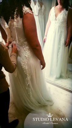 Plus size sparkling wedding gown Julia on a fitting with real curvy bride at Studio Levana
