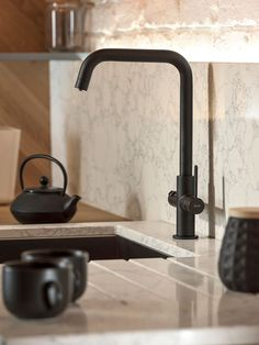 Get instant steaming hot water when you need it, as well as a stylish upgrade for your kitchen with the Prothia Quad 3-in-1 Kitchen Tap from Abode. Key features: Contemporary slimline quad neck design Instant steaming hot water 180-degree rotation of the spout for easy use and accessibility Easy to install and maintain Compact 2L boiling water tank fits neatly under your sink Minimum 1.5 bar hot water pressure and 0.8 bar cold water pressure Requires one hole of 48mm diameter Height: 352mm, Exit Black Kitchen Taps, Black Kitchens, Kitchen Trends, Kitchen Ideas, Kitchen Design, Well Water Pressure Tank, Boiling Water Tap, Water Filter Jugs
