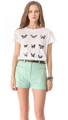 Wildfox: Warhol Butterflies Tee - Andy Warhol's vibrant pop butterflies bring a cool graphic edge to a casual jersey tee, which is distressed with holes and worn spots for a well-traveled finish. Fabric: Lightweight jersey. 100% cotton. Wash cold. Made in the USA. Length: 26 in, from shoulder $64