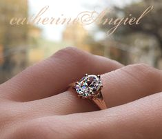 Oval diamond engagement ring set in a warm rose gold by Catherine Angiel