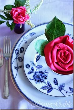 A pink flower napkin fold is such a perfect idea for a Valentine's Day tablescape! See 20 Plus Fun Everyday and Holiday Napkin folding styles. #tablescape #entertaining