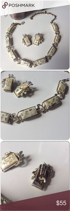 VINTAGE CORO CONFETTI DEMI PARURE IN GOLD & CREAM Demi parure signed Coro thermoset confetti earring & necklace in cream with gold flecks & subtle greens, yellows!  The earrings can be worn by anyone because they are clip ons!  Necklace is set in GP leafed vines with hook & ball closure which allows for some adjustment. There is some discoloration  as you would expect the glue to yellow over time & also some erosion in spots to the plating but this set is noticed for its elegance & timeless…