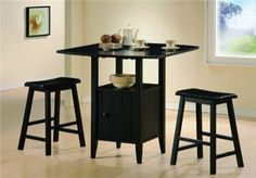 3 Pc Black Finish Counter Height Drop Leaf Pub Set with Saddle Stools Featuring Classic design in modern style and great comfort, this set is sure to add a Contemporary Dining Room Sets, Modern Dining Room Tables, Small Kitchen Table Sets, Small Dining, Pub Table And Chairs, Counter Height Table Sets, Patio Bar Set, Pub Set, Drop Leaf Table