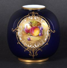 A SMALL ROYAL WORCESTER BLUE VASE painted with a panel of fruit by F. Geese