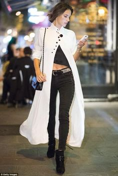 Alessandra Ambrosio wearing Apple Iphone Smart Battery Case in White, Ellery Nitehawk Bubble Sleeve Dress, Made Gold Betty Lace Up Jeans and Chanel Python Bag