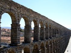 The size of Segovia's aquaduct in Spain is overwhelming. The little Chinese alphabet character in the bottom right corner of the picture is actually two people standing on the road.