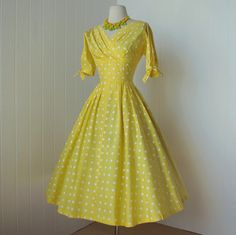 Stunning 1950s vintage dress in canary yellow with white polka dots.