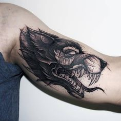arm tattoo of wolf made with watercolors for men dangerous tattoo ...