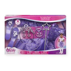 From fairy princess to ballerina diva, the Dream Dazzlers Tutu Fashion Playset has everything your gal needs to go all-out glam! This Toys'R'Us exclusive set contains a tiara, wand and shoes, plus plenty of sparkling jewelry to look positively posh. Best of all, the tutu and purse are detailed with a glittery filigree pattern as elegant as her royal highness. <br><br>The Dream Dazzlers Tutu Dress Up Set - Purple Features:<br><ul><li>Includes a tiara, shoes, handbag, wand, tutu, bangle…