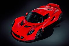 """The """"Venom Red"""" hypercar can be seen cruising the streets near the historic Silverstone Circuit, not far from the facility where the Venom GT is assembled."""