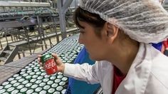 Woman holds new Coca-Cola with stevia by production line Coca Cola, Stevia, Woman, News, Business, Coke, Women, Store, Business Illustration