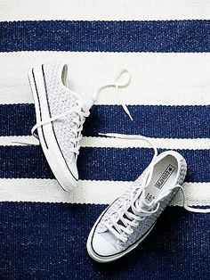 Woven Suede Lo Top | Classic low top Converse lace-up sneakers featured in a textured suede woven. Rubber trim and toe cap.