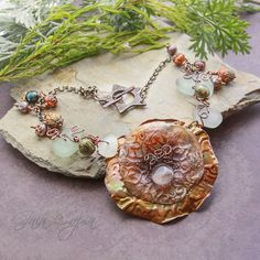 Bead Soup Challenge 2013  Partner~Staci Louise Originals  For this necklace I used the agate drop Staci sent me for the focal and wire wrapped her sea glass and pearls for the sides. I also used the chain she sent and her awesome handmade clasp. The agate is nested inside of textured polymer clay and copper sheet metal with a heat patina.