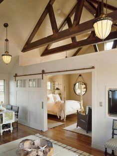 Decorating, Charming Beach Style Bedroom With Remarkable White Barn Doors Interior Also Elegant Pendant Lights Also Brown Laminate Floor Also White Elegant Canopy Bed Also Plait Armchair Also Elegant Dining Set: Industrial House Decor with Barn Doors for Homes