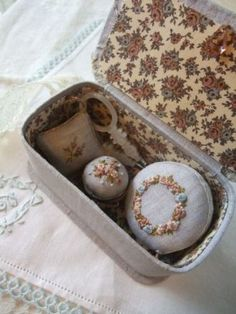 embroider with silk ribbon and store in a lovely keepsake box
