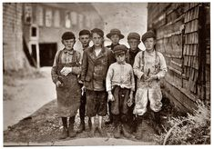 U.S. Cutting crew, 1911, Eastport, Maine. All these boys were cutters in the Seacoast Canning Company, Factory #7. Their ages ranged from 7 to 12.  The seven year old boy in front, Byron Hamilton, has a badly cut finger, but helps his brother regularly. Behind him is his brother George, eleven years old. He cut his finger half off while working.  At times they started work at 7am & worked all day & night until midnight. The work was very irregular.  Photograph by Lewis Wickes Hine  jj