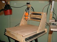 "About 10 years ago I discovered CNC routers and wanted one on my bench sooo badly!  Normally I can convince my wife to hand me the checkbook for a trip to my favorite tool store fairly easily, she asks me to do a particular project and I always reply ""yea honey, gonna need a new tool for that though"", but even I flinched at the $6000 price tag for a table saw sized CNC machine at the time.  So I did my research and cobbled together a pretty decent machine for around $300."